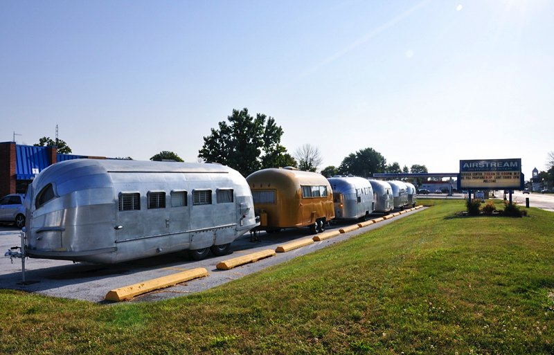 A row of historic Airstreams in front of their offices and GIFT SHOP!!!!