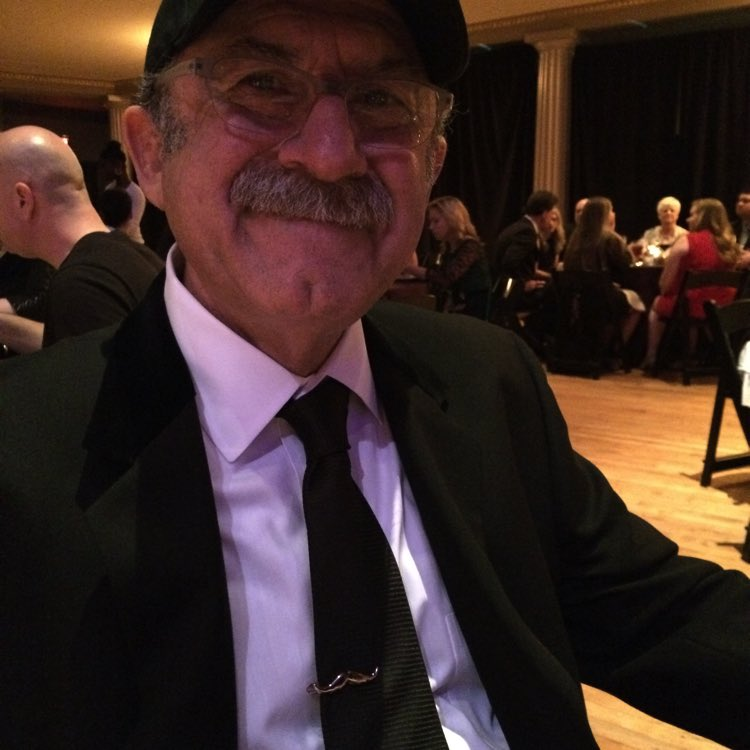 Bob with his new mustache tie clip…he gave it to the bride's father because he has an even BETTER mustache!