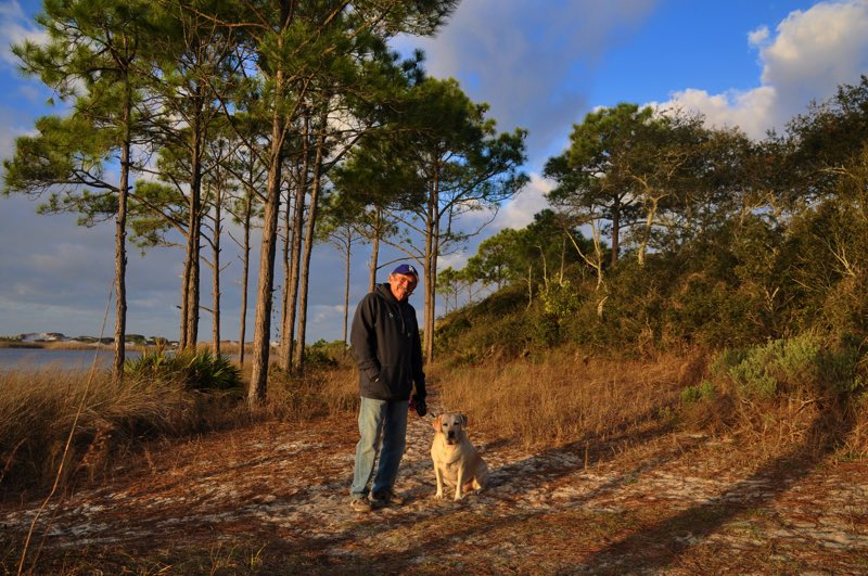 Sunrise walk by the lake, with dunes in the background