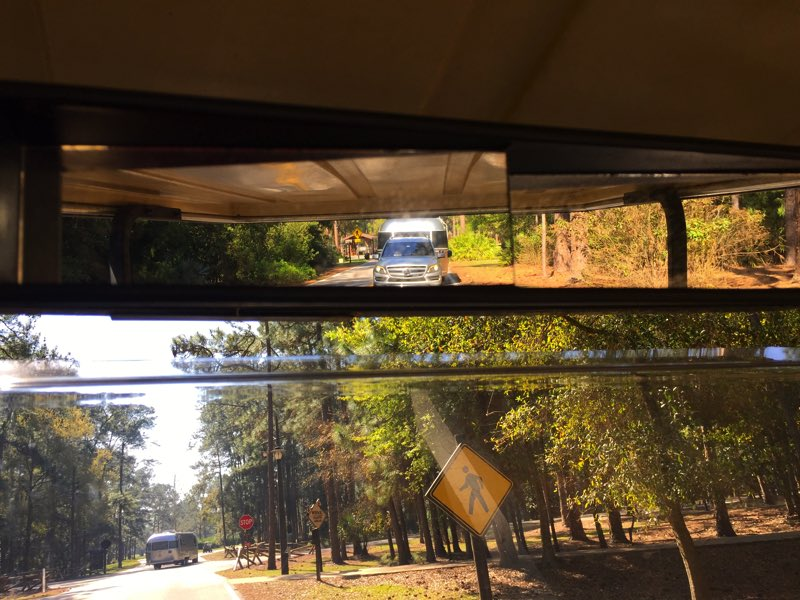 While returning our rented golf cart, I was able to capture a photo of our June Bug in my rearview mirror and another Airstream turning in front of me!