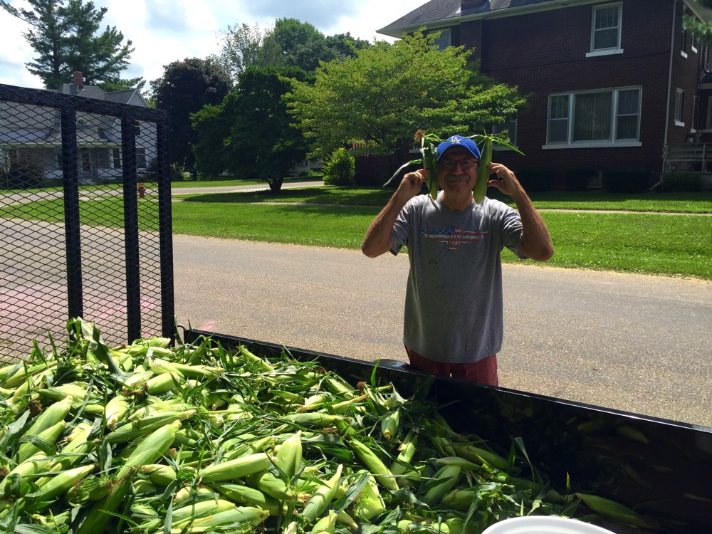 Free sweet corn up at the park. The brick house in the background is where our mom and dad were married in 1944.